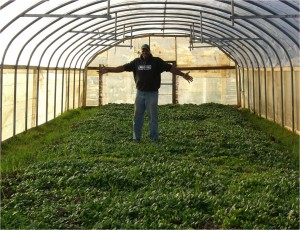 Will Allen inside his hoop house, an example of integrated farm design
