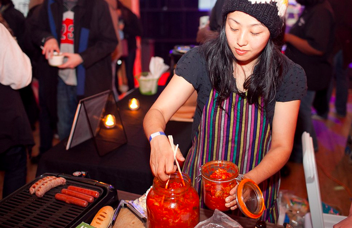 Foodies try kimchi and other goods at the underground market.