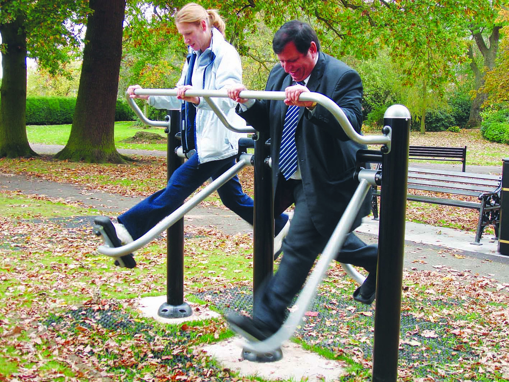Adults playing exercise playground
