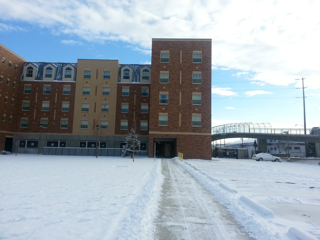 One of the many University-owned housing options on campus, with secured parking available on the first floor.