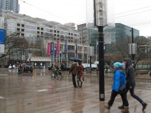 The Robson Street square is fractured by the opening of the street to car traffic