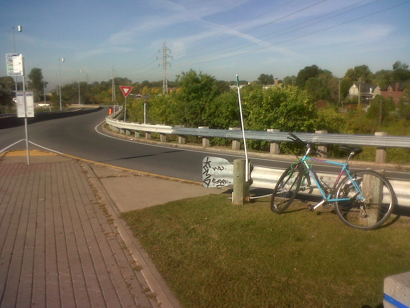 Bicycle attached to the highway entrance ramp