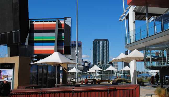 Dockland's outdoor cafe seating areas are seldom occupied.