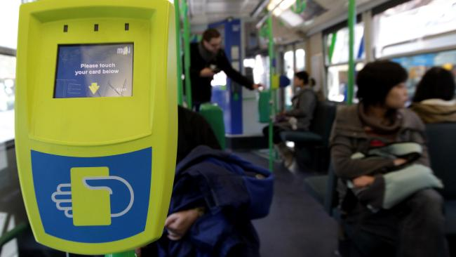 MYKI ran concurrently with the Metcard system (Green machine in the background) from 2010-2012. (TheAge,2012)