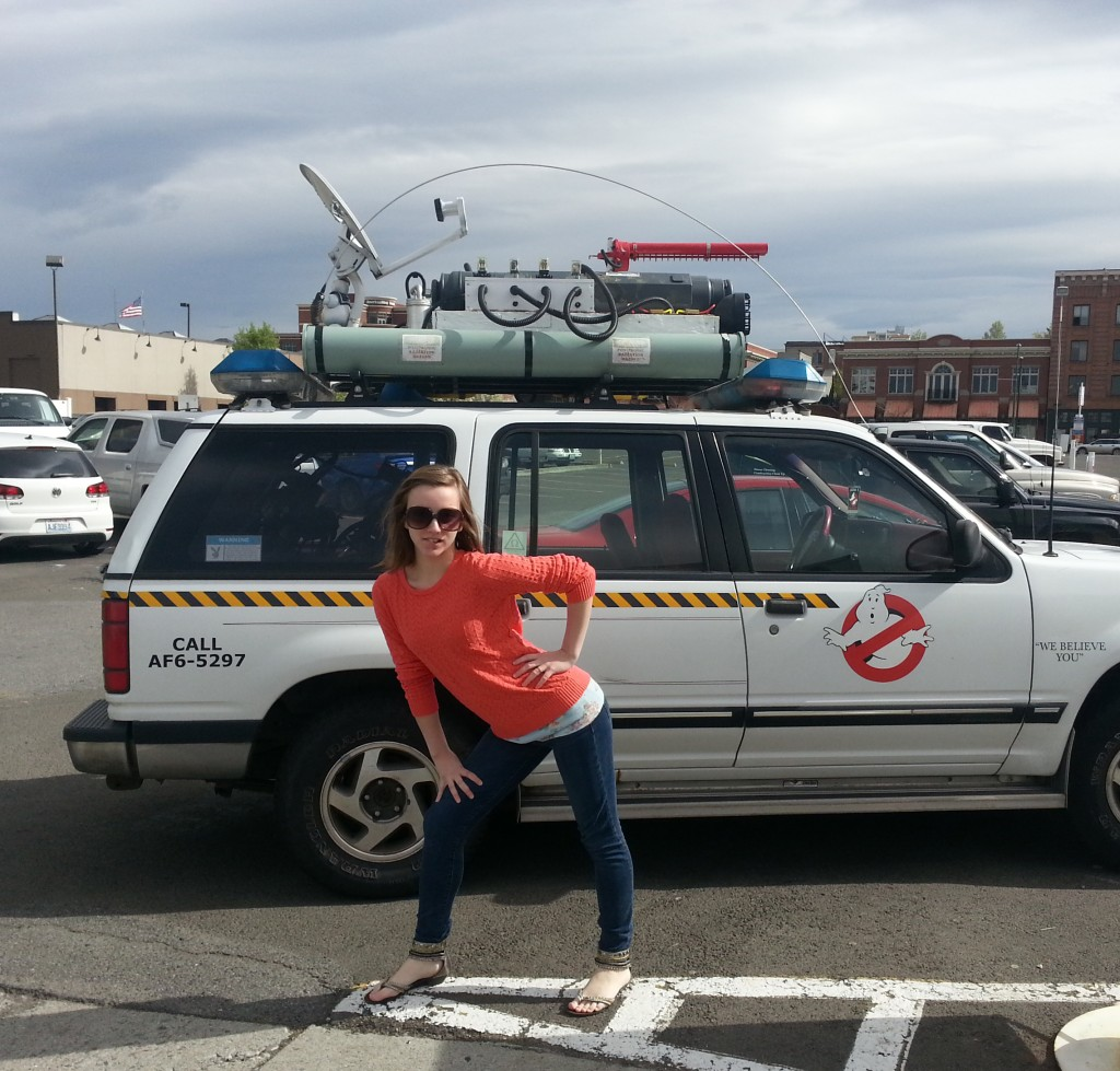 Aascot Holt next to a Ghostbusters Themed SUV