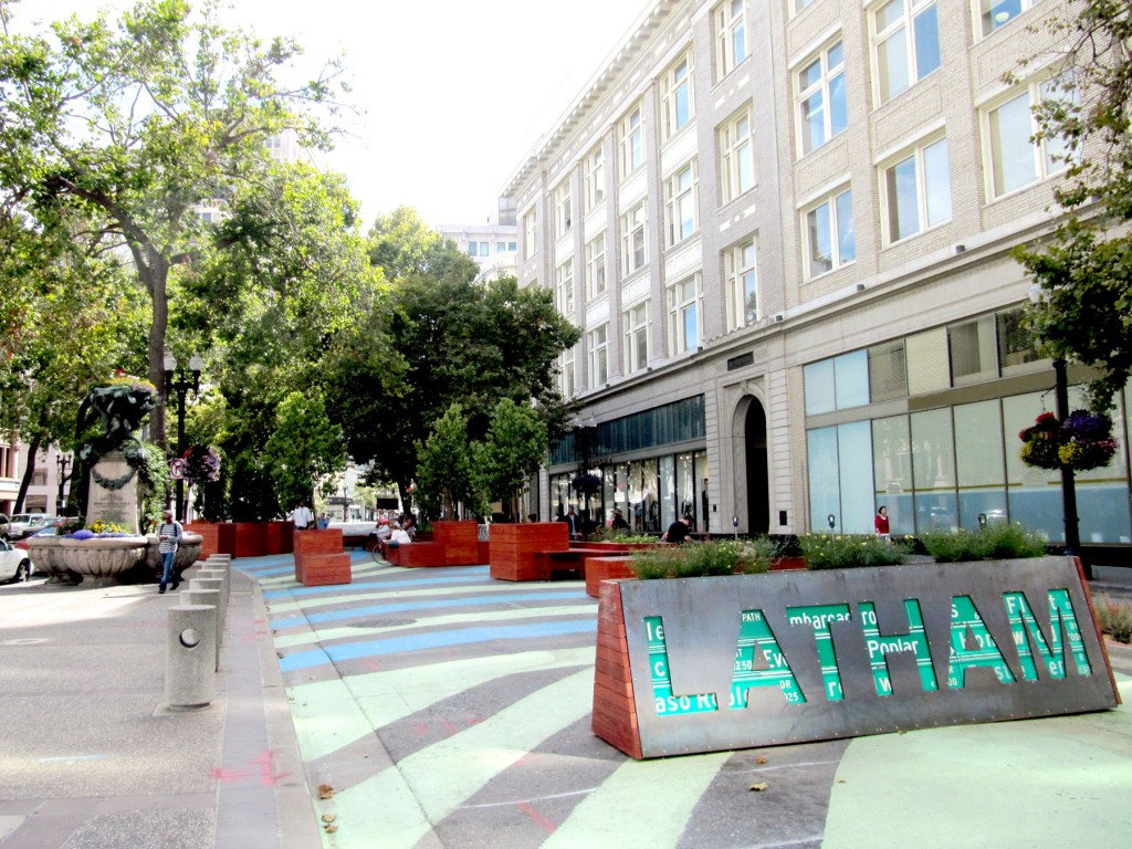 "Telegraph and Broadway After Pilot Renovations - Of the first mobile elements, a ""Latham"" sign constructed with reclaimed street signs from the city is among the first recycled pieces using materials from Oakland's maintenance yards."