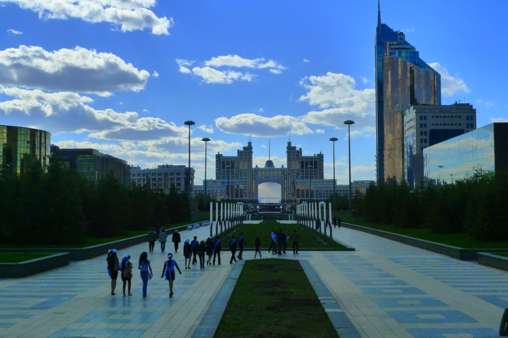 The Khan Shatyr, framed by the KazMunaiGas Building, Astana, Kazakhstan