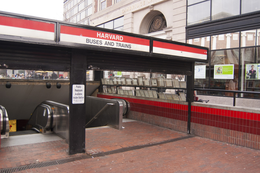 The main entrance to Harvard Square's subway station, indicating that public restrooms are available