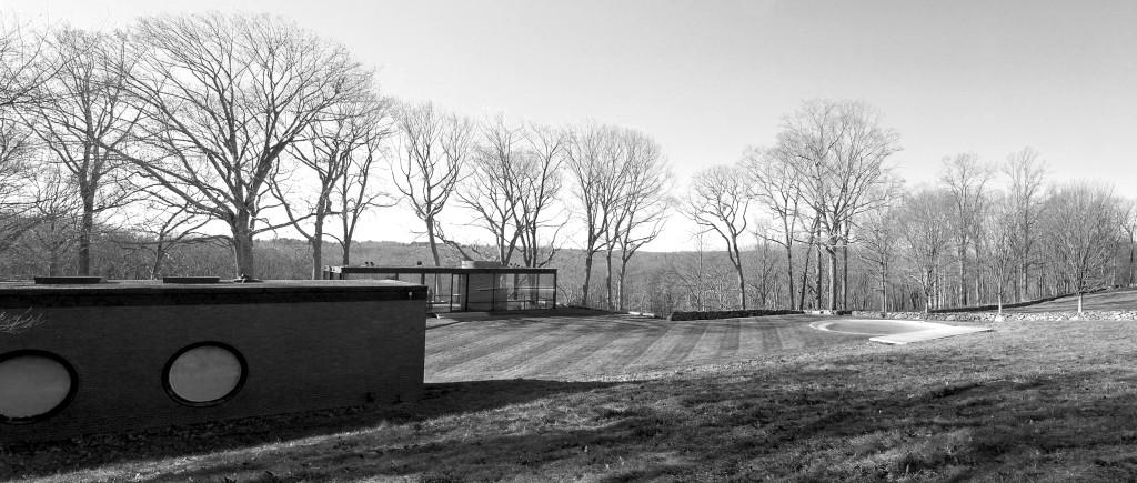 Philip Johnson's Glass House and Brick House, in front. The Brick House is currently undergoing restoration.