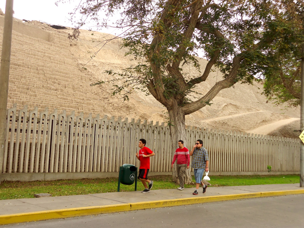Walkers and joggers around Pucllana, Lima, Peru