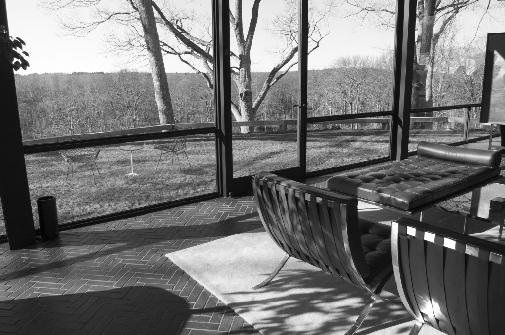 The Glass House's living room, featuring Mies van der Rohe's trademark Barcelona chairs
