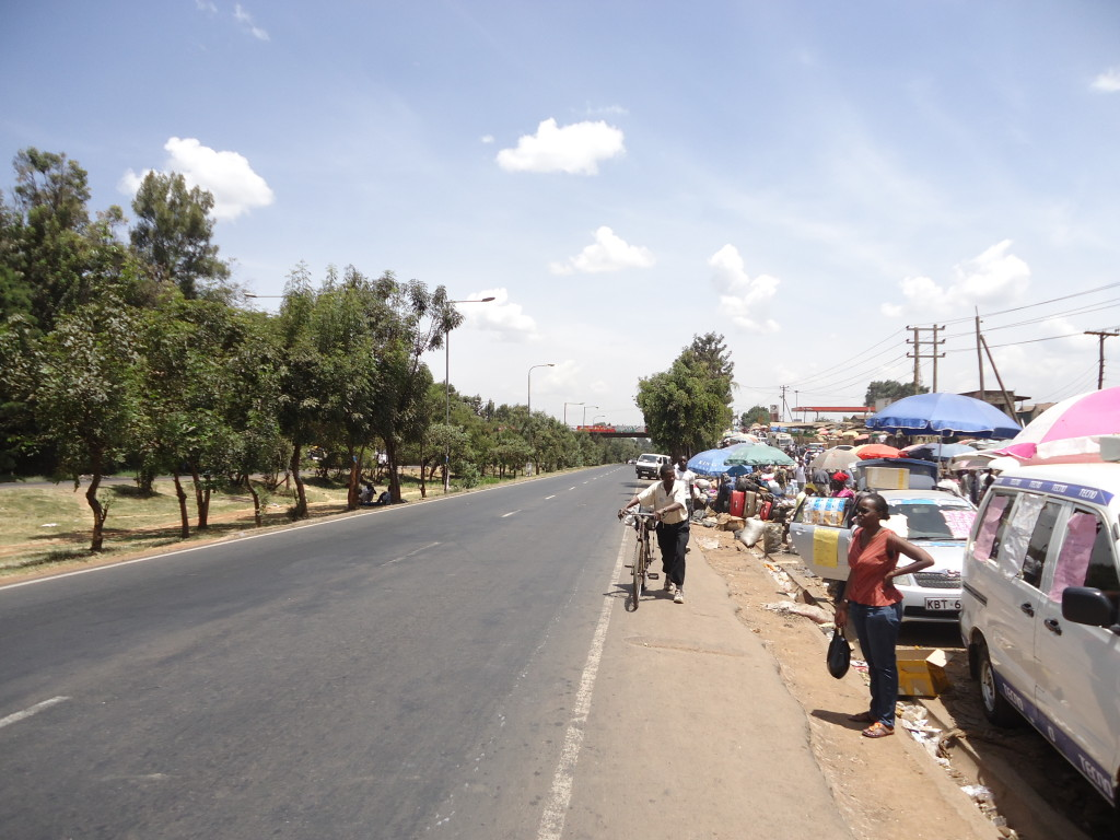 A very Narrow Pavement as cars and stall owners have encroached the wider side in Nairobi