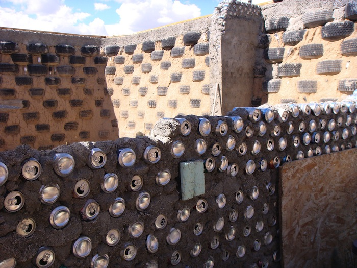 Cans incorporated into the wall of a construction project