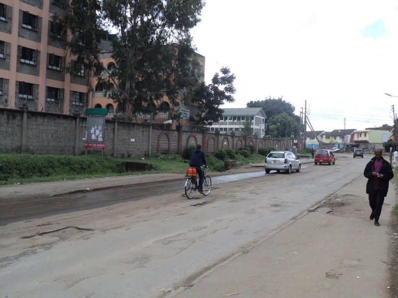 A cyclist moves on the middle of the road in Nairobi, Kenya
