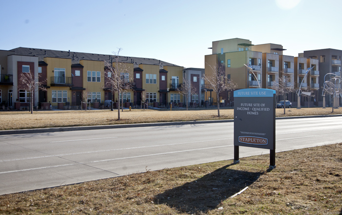 An affordable housing sign across from completed condos in Stapleton, Denver, Colorado