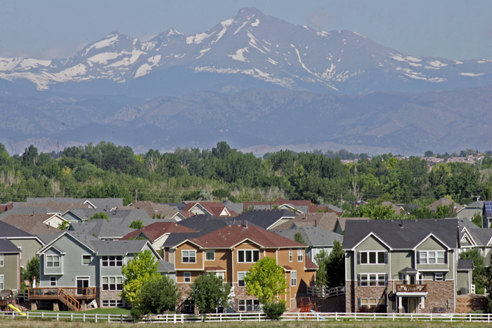 Denver area homes and a view of Rocky Mountains' Longs Peak (14,259 feet)