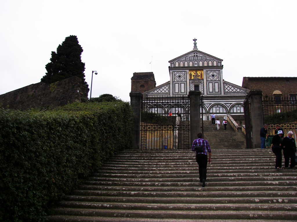 The facade of Sa Miniato al Monte, one of the oldest chhurches in Florence, that served as a model for the next facade generation, Florence, Italy
