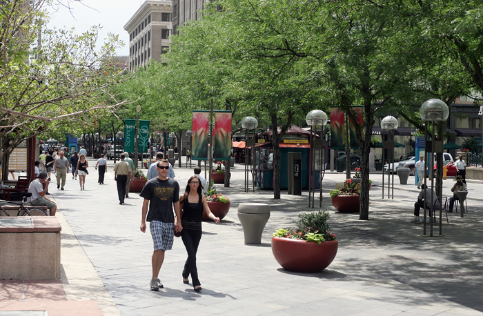 Pedestrians walk down the 16th Street Mall in Denver, Colorado