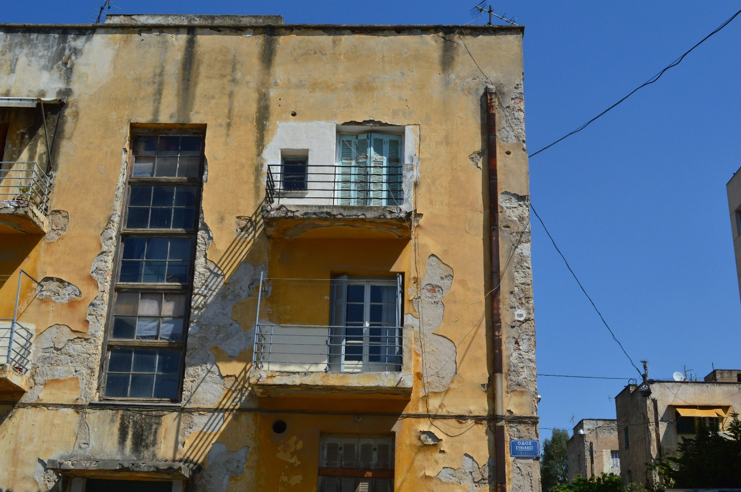 Narrow balconies on the cubical building, Former Refugee Houses, Athens, Greece