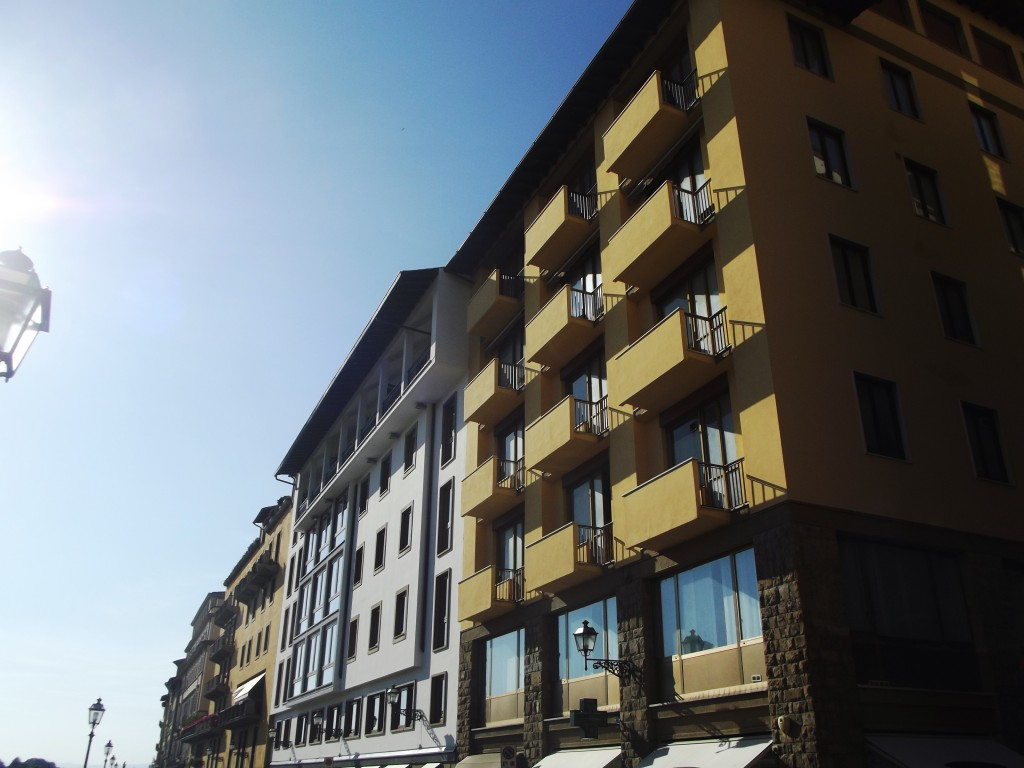 The buildings of the river coast in the center of Florence, with architectural elements that remind much older eras, Florence, Italy