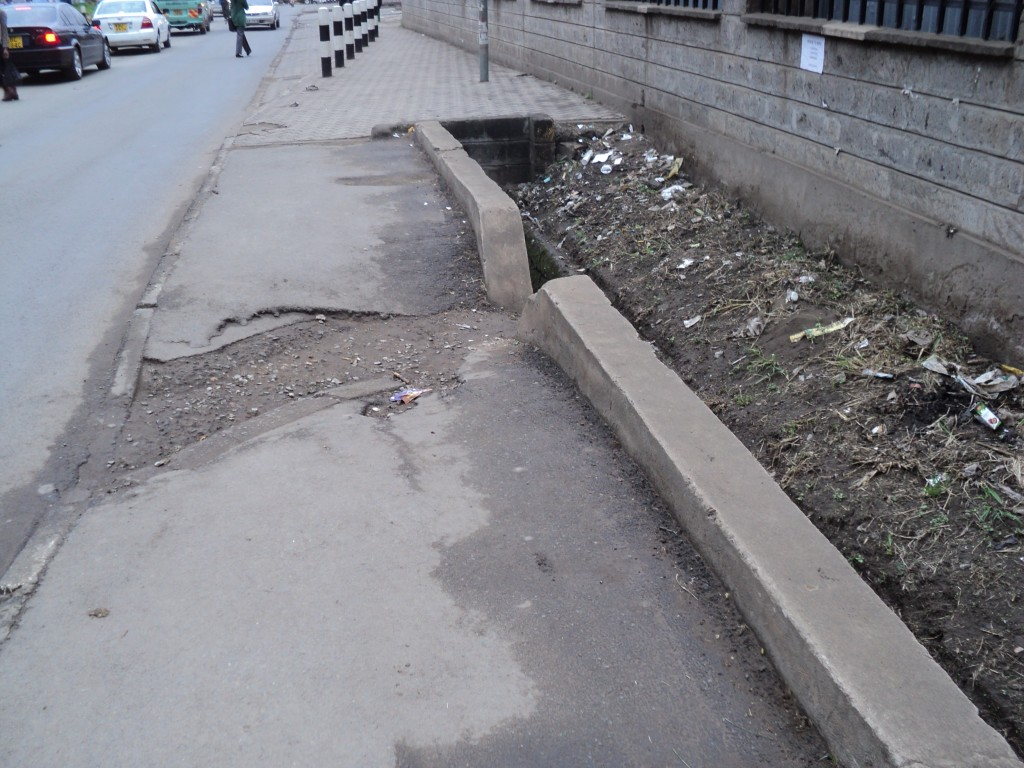 Pavements that have water trenches make it hard for persons with disability to move, Nairobi, Kenya