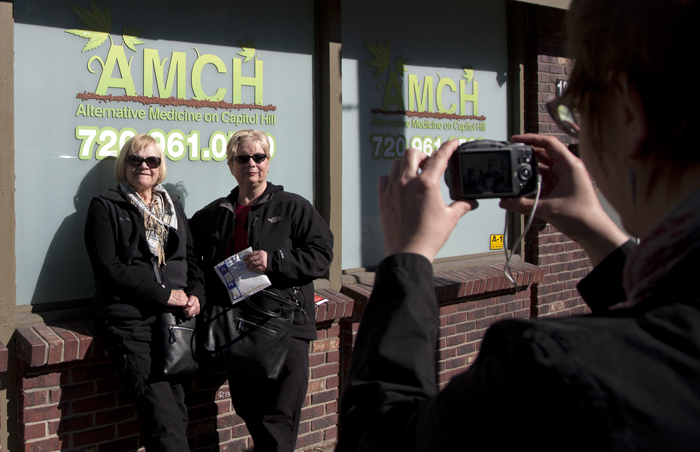 Tourists outside a recreational marijuana shop in Denver, Colorado
