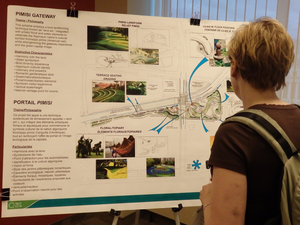 Open houses attendee looking at Pimisi Gateway design proposal, Ottawa, Ontario