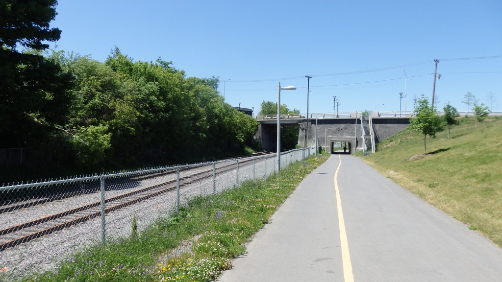 Multi-use pathway alongside train tracks, separated from urban fabric, Ottawa, Canada