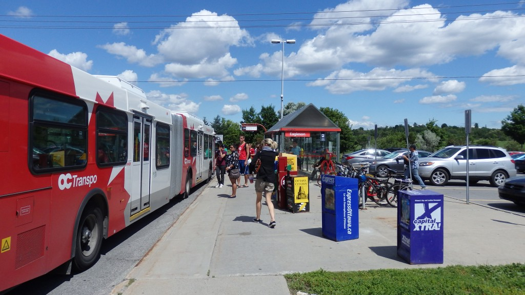 Ottawa, Canada, Cyclists leave their bikes at a Park and Ride before getting on the bus