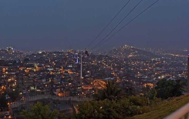 A nighttime view of Complexo do Alemão and its cable-car in Rio de Janeiro, Brazil