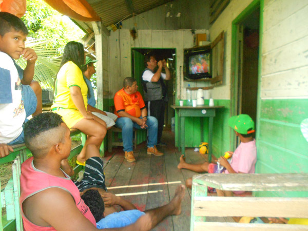 The Community gathers to watch the World Cup on televisions powered by solar power.