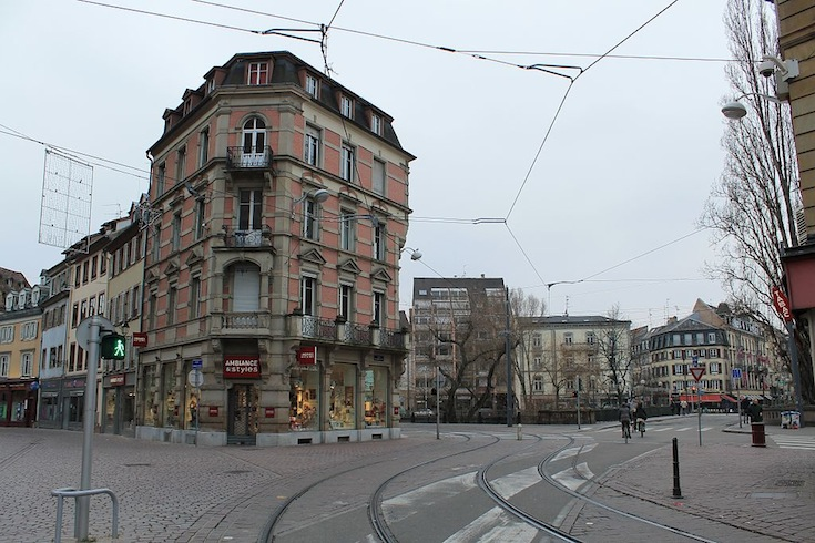 A street in downtown Strasbourg, France serviced by the existing tramline