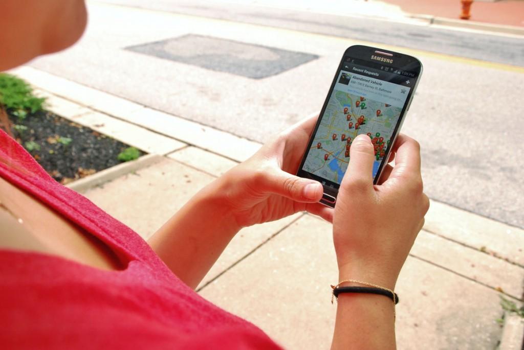 Resident using Baltimore City 311 mobile app, Baltimore, Maryland