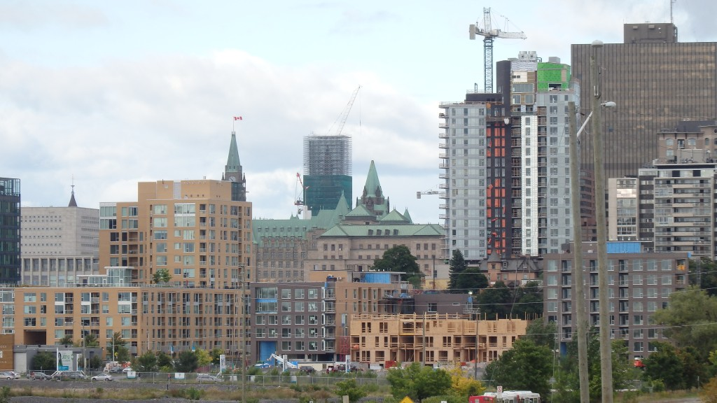 Downtown Ottawa, Canada: Parliament is barely visible through the numerous modern towers rising in the foreground