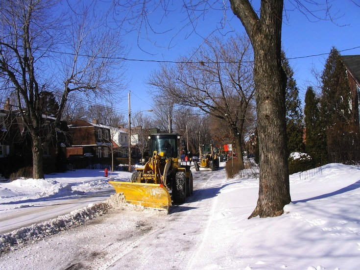 A snow removal in the streets of Montreal, Canada
