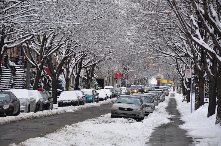 Cars parked on a snowy street in Montreal, Canada