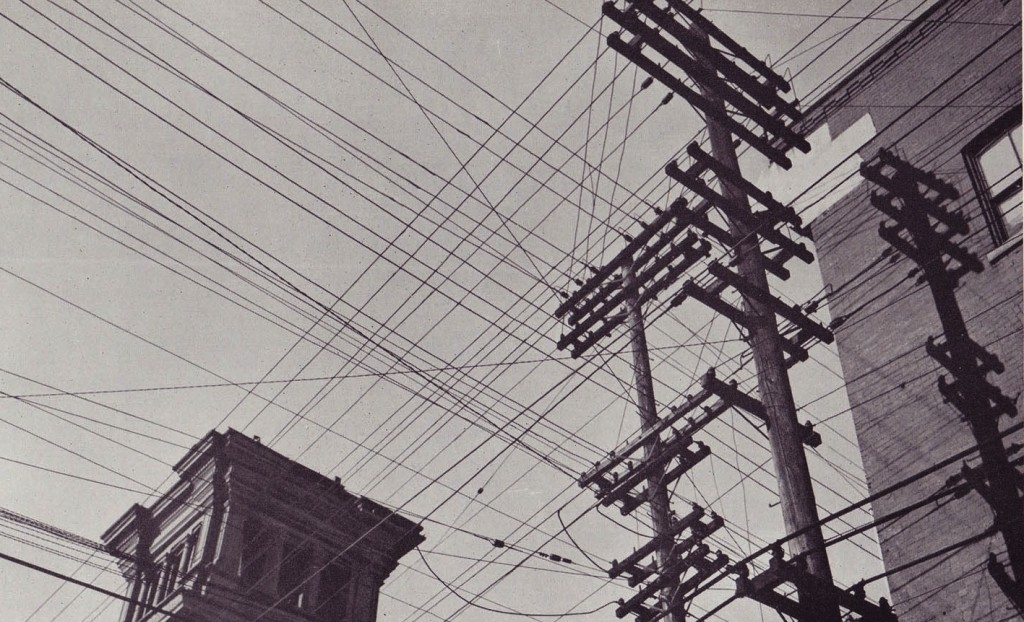 Image from Gréber Plan, showing crowded utility poles and wires overwhelming the view of the sky, Ottawa, Canada