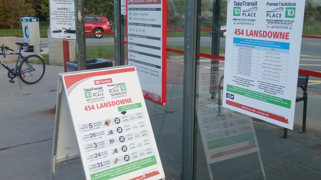 TD Place transit options displayed on a sign at Ottawa bus stop, Ottawa, Canada