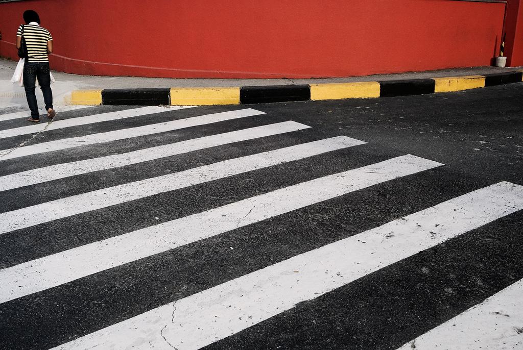 A pedestrian crosses a street in Sao Paulo, Brazil.