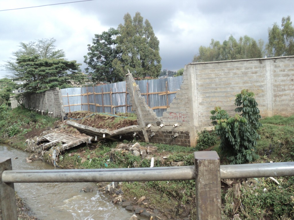 A wall put up on a riparian reserve that came down down after a heavy downpour in Nairobi, Kenya