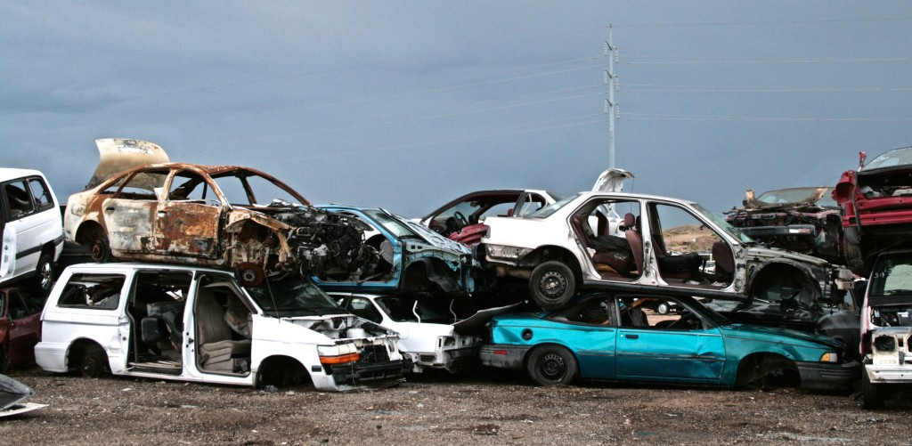Car junkyard, Albuquerque, New Mexico showing smashed cars stacked on top of one another