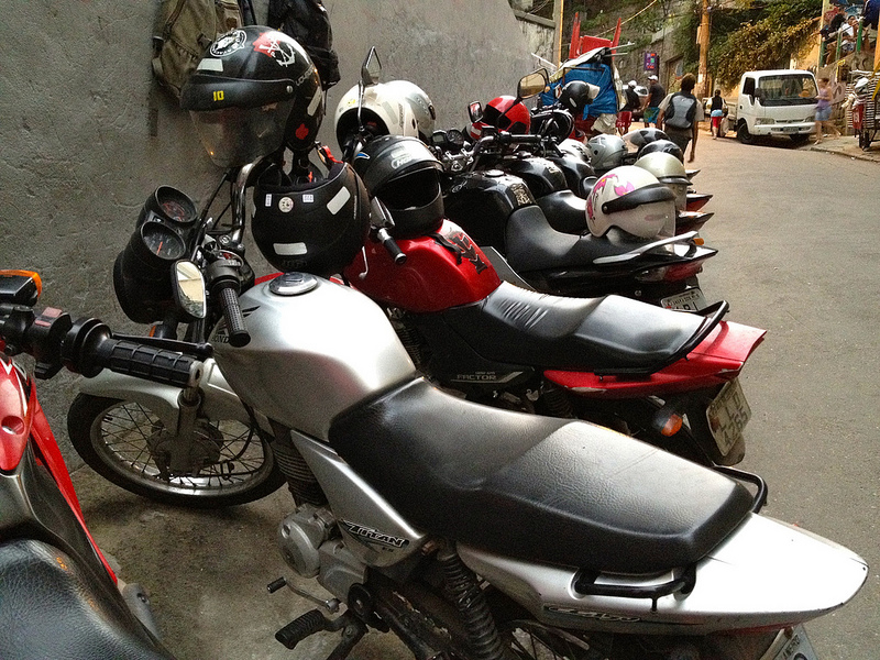 Motorcycles lined up in the Rocinha favela, Brazil.