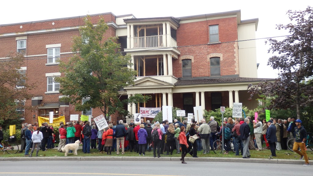 Activists in Sandy Hill neighbourhood of Ottawa protesting proposed demolition of a heritage building