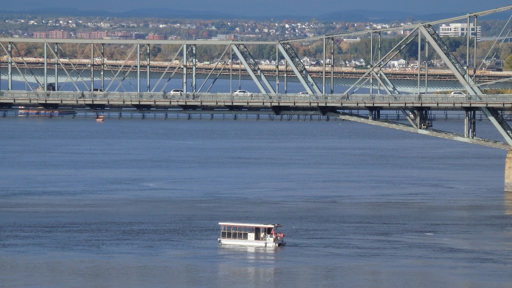 Boat crossing under Alexandra bridge in Ottawa, Canada