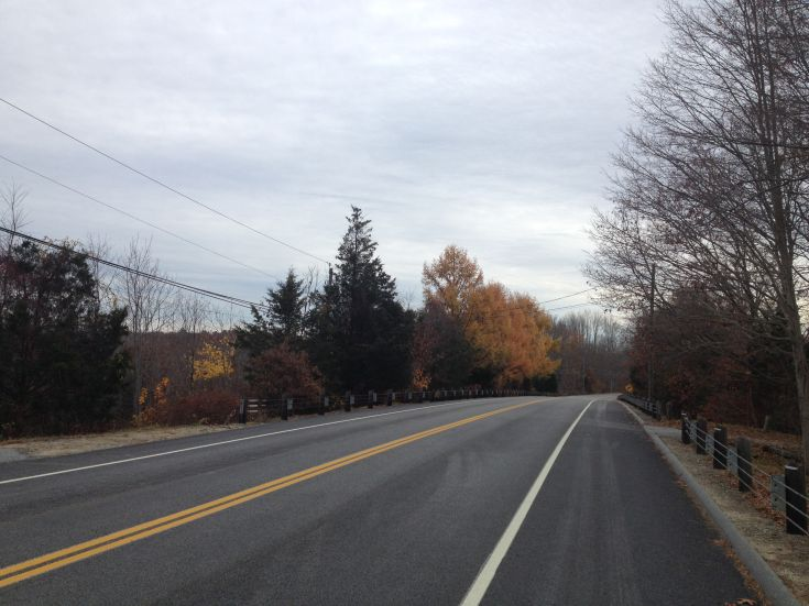 Route 169; Canterbury, Connecticut.  Fall trees line paved road.