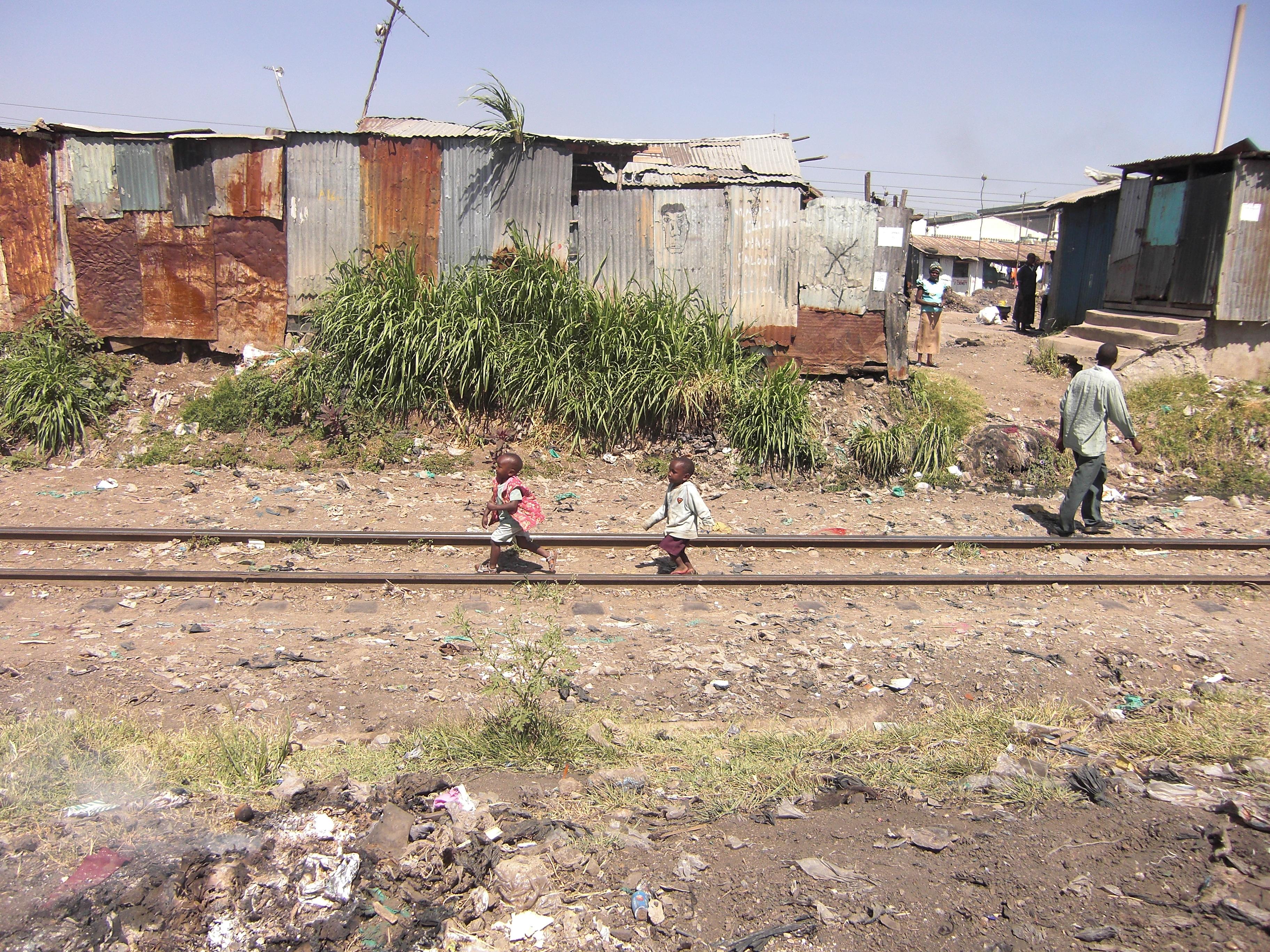 Kids playing on a railway track in Mukuru Slum, Nairobi, Kenya