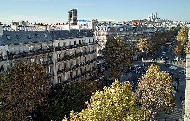 Many low-rise apartments line the Boulevard de Magenta in Paris, France