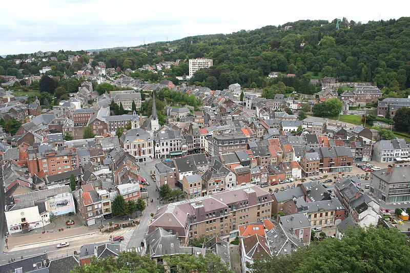 Aerial View of Huy, Belgium shows city nestled into base of a hill