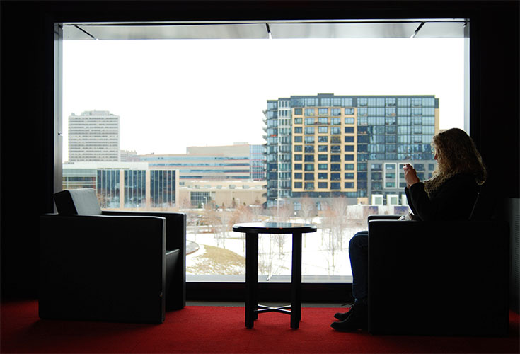 Within the Guthrie Theater, there are many spaces for socialization and relaxation. As seen here, a simple seating area  next to a large window facing South provides for an exceptional space.
