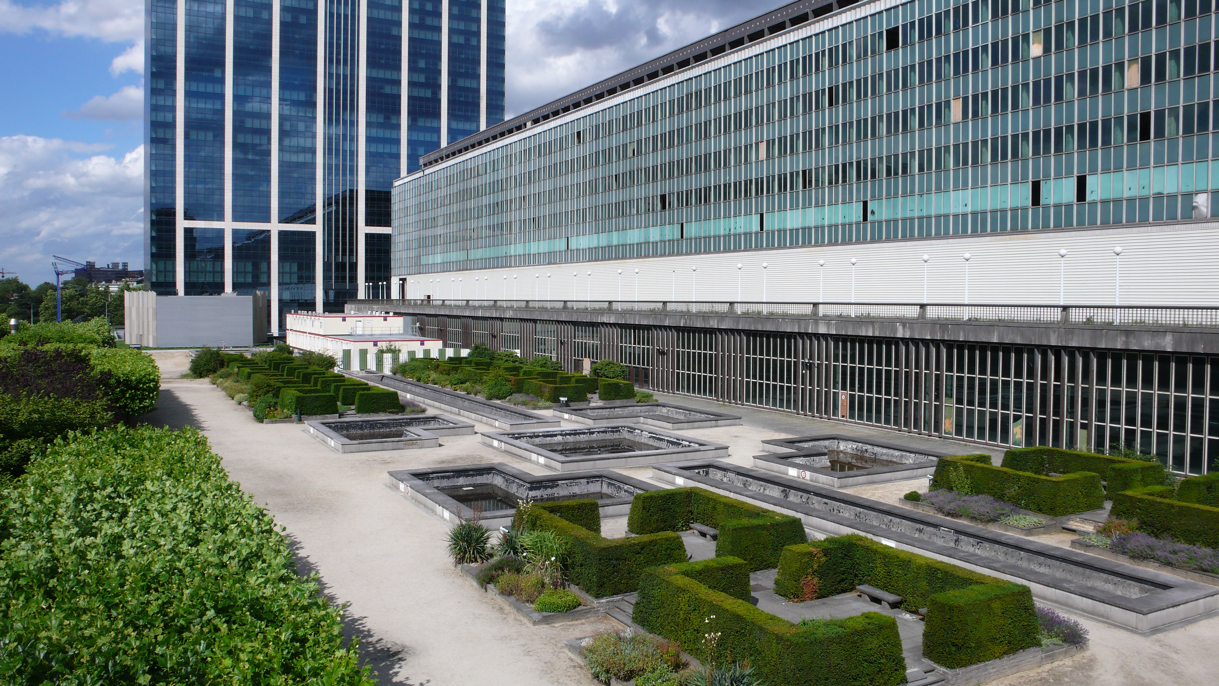René Pechère Garden Administrative Complex in Brussels, Belgium. View of geometric gardens with modern administrative buildings in background